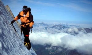 Mountain climber looking at view