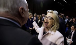 Secretary of State Hillary Clinton has a hilarious reaction to seeing Senate Foreign Relations Committee member John McCain on Capitol Hill in Washington, prior to the start of the committee's confirmation hearing for Senate Foreign Relations Chairman John Kerry to replace her as secretary of state.