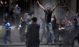 Egyptian protesters try to tear down a cement wall built to prevent them from reaching parliament and the cabinet building near Tahrir Square on Thursday.