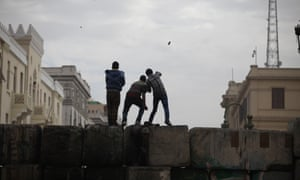 Skirmishes break out between protesters and security forces, unseen, near Tahrir Square.
