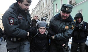 Police detain a gay rights activist during a protest outside the State Duma in Moscow
