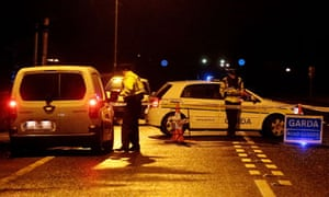 Irish police man a checkpoint near the scene where a detective was shot dead in Dundalk