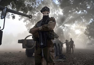 20 Photos: A French soldier wearing a skeleton mask in a street in Niono, Mali