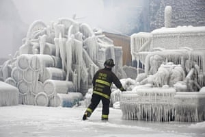 20 Photos: Chicago Fire Department Lieutenant walks around an ice-covered warehouse