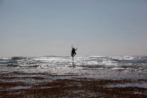 20 Photos: A fisherman sat on a traditional stilt in Sri Lanka