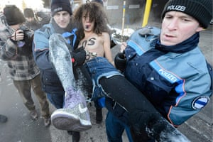 Femen: Police arrest a protester at the entrance to the congress center