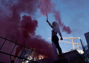 Femen: Activist from Femen protests outside World Economic Forum in Davos