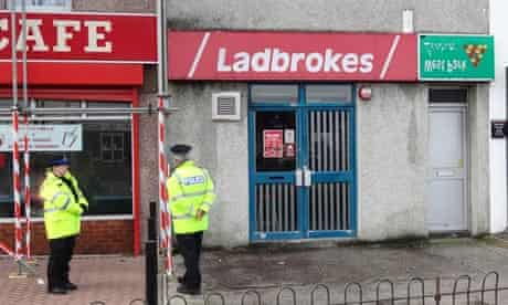 Police at the Ladbrokes branch on Crownhill Road, Plymouth, Devon