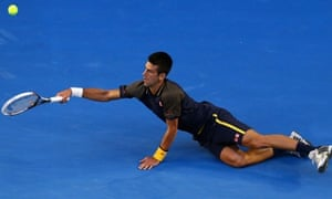 Djokovic dives for a forehand.