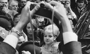 Mandy Rice-Davies framed by photographer's arms