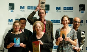 Man Booker Prize shortlisted authors pose for photographers during a event in central London