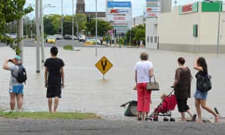 Bundaberg in Queensland is cut in half by floodwaters