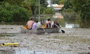 Also in Australia: people in a boat negotiate flood water and debris in the town of Bundaberg in Queensland. At least 1200 Bundaberg properties are already flooded, and there are fears that the could reach 2000 following tropical cyclone Osward at the weekend.