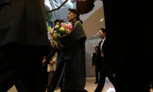 Myanmar's opposition leader Aung San Suu Kyi is surrounded by security people on her arrival at Incheon international airport west of Seoul, South Korea today for her five-day trip to the country.
