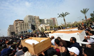 Egyptian mourners carry the coffins of six people killed in clashes the day before, during their funeral in Port Said, on Monday. President Mohamed Morsi sought to crack down on violence which has swept Egypt since January 26 in which more than 45 people have died after a Cairo court handed down death sentences on 21 supporters of a local football club, Al-Masry, in the wake of football violence in 2012. Morsi declared a month-long state of emergency in the provinces of Port Said, Suez and Ismailiya.