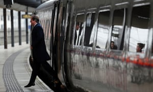 David Cameron arrives by train for a regional cabinet meeting in Leeds.