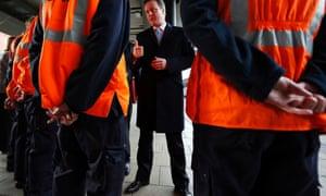 Prime Minister David Cameron speaks with Network Rail apprentices at Leeds station, Leeds.