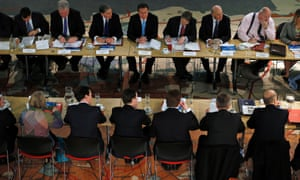 Cameron (top centre) listens during a regional cabinet meeting in Leeds.