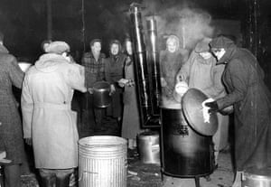 Floods 1953: Flood Victims From Canning Town London Being Fed By A W.v.s. Soup Kitchen