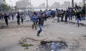 Egyptian protesters battled police with rocks along the Nile River near Tahrir Square in Cairo for a fifth consecutive day on Monday.