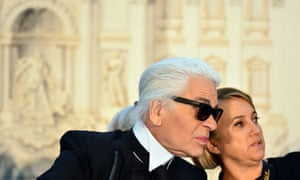 Fendi's designers Karl Lagerfeld and Silvia Venturini Fendi react during a press conference announcing Fendi would finance a renovation of the Trevi Fountain in Rome.