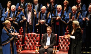 Actor Liam Neeson, is applauded by councillors at the town hall after accepting the freedom of Ballymena, his home town in County Antrim, Ireland.