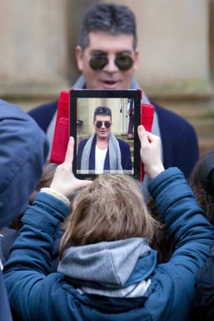 Simon Cowell being filmed on an iPad outside the Britain's Got Talent TV programme auditions, in Glasgow, Scotland.