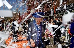 Queen Beatrix: Queen Beatrix is showered with streamers