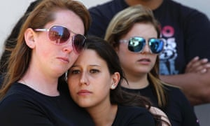 Friends of victims of the fire at Boate Kiss nightclub stand in front of the club in the southern city of Santa Maria, Brazil.