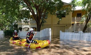 Rescuers check a flooded area of Rosalie in Brisbane, the Queensland capital