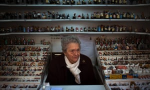 Aurora waits for customers at her shop selling figures to decorate the Christmas crib, in Barcelona Spain, Tuesday, Dec. 11, 2012.
