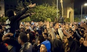 Egyptian protestors shout slogans as they demonstrate in the streets of the canal city of Port Said last night breaking the curfew the government imposed on the city. Read the latest news on the crisis.