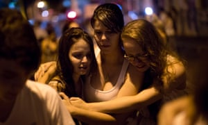 People react during a march near the Kiss nightclub commemorating the victims of Sunday's fatal fire inside the club in Santa Maria, Brazil. The tragedy was thought to be the world's worst fire of its kind in more than a decade, with 231 people dead.