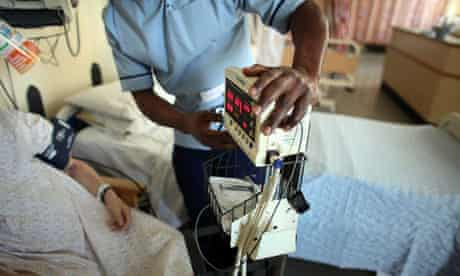 Patient being attended on hospital ward