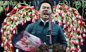 He's not just saying it with flowers...this man's shouting a message of love to his wife during a pre-Beloved Wives' Day event in Tokyo, Japan. The event was held to raise awareness about the importance of wives in marital relationships prior to 'Beloved Wives' Day' on 31 January when husbands are urged to get home early to express gratitude to their wives.