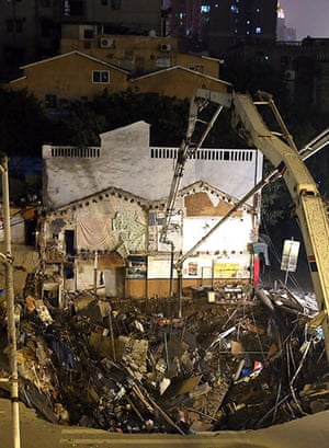 Sinkhole gallery: Rescuers at the scene of huge cave in