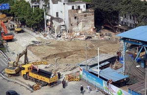 Sinkhole gallery: An area is seen cordoned off after a second cave-in