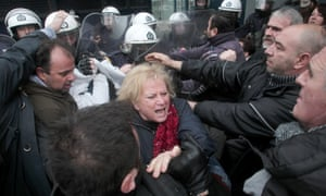 Municipal workers scuffle with riot police outside the office where tenders for landfills up for privatisation are being submitted in Athens, Greece. The protesting workers are opposed to the privatisation plans.