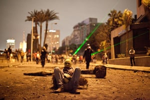 24 hours: A protester takes in Cairo, Egypt