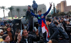 Protesters celebrate the capture of a state security armored vehicle commandeered during clashes with security forces and brought to Tahrir Square in Cairo, Egypt. The country's army chief has warned of the collapse of the state if the current crisis continues, but said the armed forces will respect the right of Egyptians to protest.