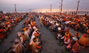 As the sun goes down hundreds of Hindu holy men are given charitable food on the banks of the river Ganges during the Kumbh Mela festival in Allahabad. The fesitval is one of the world's largest religious gatherings, lasting for 55 days and taking place only every 12 years.