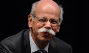 Something seems to be tickling Dieter Zetsche, Chairman of German carmaker Daimler AG during the CAR-Symposium in Bochum, Germany. What could it be I wonder?