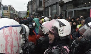 ArcelorMittal workers in Belgium clash with paint covered riot police, against steel plant closures in the province of Liege. Photograph:  Terry Sonveaux/Demotix/Corbis