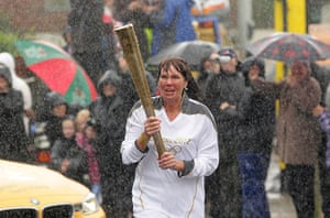 Wet UK weather 2012 : July: Olympic Torch Relay in rain