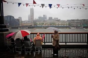 Wet UK weather 2012 : June: Hardy royalists huddle under umbrellas