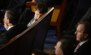 A boy sleeps on the House floor during the opening session of the 113th Congress.