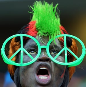 We come in peace. A Zambian soccer fan reacts during their African Cup of Nations match at Mbombela Stadium in Nelspruit, South Africa.
