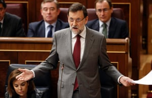 Spanish Prime Minister Mariano Rajoy gestures as he answers a question from the opposition during a government's control session at Parliament in Madrid January 30, 2013.