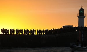 Spectators attend the arrival of English skipper Alex Thomson on his monohull as he placed third in the the Vendee Globe solo round-the-world race in Les Sables d'Olonne, western France.