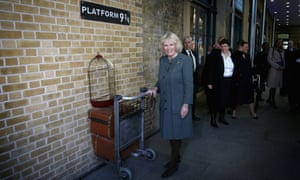 Heading to Hogwarts? Camilla, Duchess of Cornwall visits platform 9 3/4 at Kings Cross Rail Station during a visit to mark 150 years of London Underground.